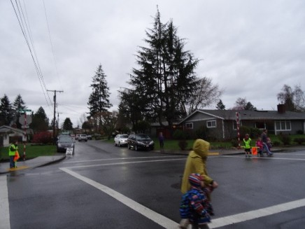 Student crossing guards working an intersection next to Newport Heights Elementary School